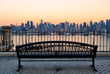 Bench in Park and New York City Midtown Manhattan at Sunset with Skyline Panorama View Fotografiskt tryck av Songquan Deng