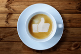 Thumbs Up or Like Symbol in Coffee Froth Photographic Print by  Flynt