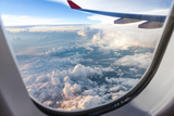 Clouds and Sky as Seen Through Window of an Aircraft Photographic Print by  06photo