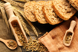 Rye Spikelets and Bread on Wooden Background Fotografisk tryk af  haveseen