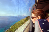 Woman in the Bus Looks Out of the Window on a Sea Landscape Photographic Print by  igorr