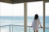 Rear View of Young Woman Looking at Sea View from Balcony at Resort Photographic Print by  Nosnibor137