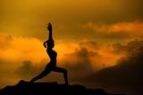 szefei - Silhouette of Woman Doing Yoga Meditation During Sunrise with Natural Golden Sunlight on Mountain - Fotografik Baskı