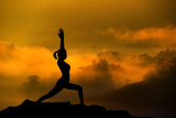 Silhouette of Woman Doing Yoga Meditation During Sunrise with Natural Golden Sunlight on Mountain Poster by  szefei