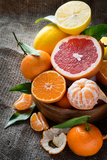 Fresh Citrus Fruits on Rustic Background Print by  katerinabelaya