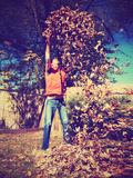 A Young Man Throwing Leaves in the Air Print by  graphicphoto