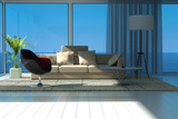 A Sunny Living Room with Large Windows Photographic Print by  PlusONE