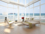 A Loft Apartment Interior with Seascape View Print by  PlusONE