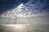 Beautiful Inspirational Sun Beams over Ocean on Cloudy Day Photographic Print by  Veneratio