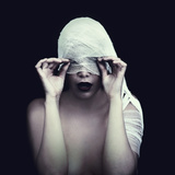 Woman in Bandage over Black Background Photographic Print by  viczast