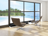 Two Lounge Chairs Against Huge Window with Seascape View Print by  PlusONE