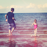 Father and Little Girl Playing in Water at Beach Posters by  melking