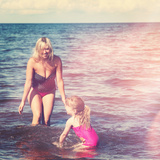 Mother and Little Girl Playing in Water at Beach Prints by  melking