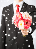 Love, Romance, Holiday, Celebration - Young Man Giving Bouquet of Flowers Photo by  dolgachov