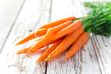 Fresh Carrots on Wooden Background Photographic Print by  Kesu01