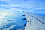 Wing of an Airplane Flying Above the Clouds Reproduction photographique par  ghoststone