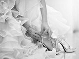 The Bride is Putting on Her Shoes for the Wedding Day Photographic Print by  szefei