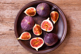 Fresh Figs in a Plate on Rustic Wooden Table Photographic Print by  Marylooo