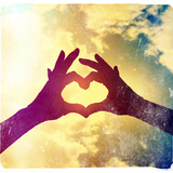 Two Hands Making a Heart Shape in the Sky Photographic Print by  graphicphoto