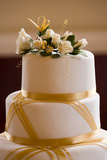 Top of Wedding Cake Decorated with Roses and Gold Ribbon Prints by  alpha234