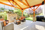 Exterior Covered Patio with Fireplace and Furniture Photographic Print by Iriana Shiyan