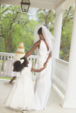 African American Bride Dancing with Flower Girl Poster by  Blend Images