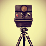 Picture of an Old Instant Camera in a Tripod with a Retro Effect Prints by  nito