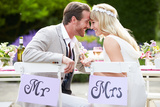 Bride and Groom Enjoying Meal at Wedding Reception Photographic Print by  monkeybusinessimages