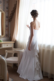 Beautiful Bride in White Wedding Dress Standing in Her Bedroom and Looking in Window Reproduction photographique par  Malyugin