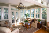 Furnished Sunroom with Large Windows and Glass Doors Poster by  Wollwerth Imagery