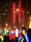 Giant Christmas wreath in front of the Radio City Music Hall on a Winter Night Photographic Print by Philippe Hugonnard