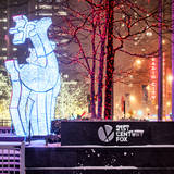 The Christmas Ornaments at 21st Century Fox across from the Radio City Music Hall by Night Photographic Print by Philippe Hugonnard