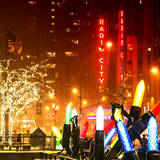 Christmas Decorations in front of the Radio City Music Hall in the Snow on a Winter Night Photographic Print by Philippe Hugonnard