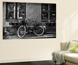 A Bicycle Parked on a Sidewalk Below Two Windows Wall Mural by Jonathan Irish