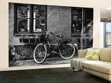 A Bicycle Parked on a Sidewalk Below Two Windows Wall Mural – Large by Jonathan Irish