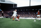 Bobby Moore Slides in to Tackle Bobby Charlton, September 1967 Photographic Print