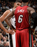 2014 NBA Finals Game One: Jun 05, Miami Heat vs San Antonio Spurs - LeBron James, Tim Duncan Photographic Print by Andrew Bernstein