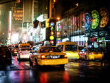 Yellow Cab on 7th Avenue at Times Square by Night Fotografisk tryk af Philippe Hugonnard