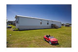 Trailer with Red Toy Car Photographic Print by Henri Silberman