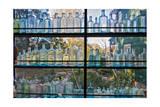 Vintage Blue Glass Bottles Against a Window Fotodruck von Henri Silberman