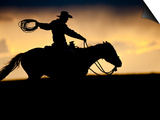 A Silhouetted Cowboy Riding Alone a Ridge at Sunset in Shell, Wyoming, USA Prints by Joe Restuccia III