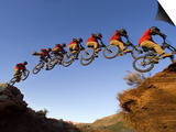 Mountain Biker Catches Air at Rampage Site near Virgin, Utah, USA Poster by Chuck Haney