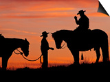 Cowboy and Cowgirl Silhouetted on a Ridge in the Big Horn Mountains, Wyoming, USA Posters by Joe Restuccia III