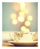 Tea Cup in Cold Bokeh Kunstdrucke von Amelia Kay