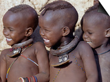 Three Happy Himba Children Enjoy Watching a Dance, Namibia Prints by Nigel Pavitt