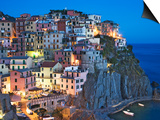 Dusk Falls on a Hillside Town Overlooking the Mediterranean Sea, Manarola, Cinque Terre, Italy Posters by Dennis Flaherty