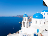 Blue Domed Churches in the Village of Oia, Santorini (Thira), Cyclades Islands, Aegean Sea, Greece Print by Gavin Hellier