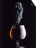 Bunch of Grapes Over a Glass of Wine Prints by Howard Sokol