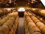 Oak Barrels in Wine Cellar at Groth Winery in Napa Valley, California, USA Plakater af Julie Eggers