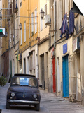 Fiat Driving in Narrow Street, Sassari, Sardinia, Italy Prints by Doug Pearson